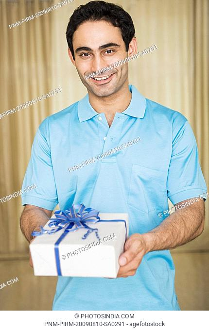 Portrait of a man holding a birthday present