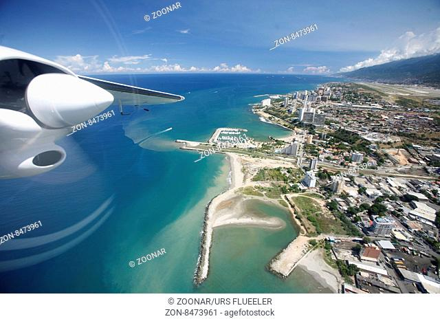 a airplane landing at the Caracas Airport at the coast of Caracas in the north of Venezuela