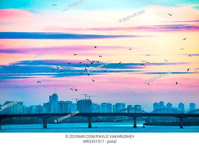 Spectacular sunset city view with bridge over Dnepr river. Kiev, Ukraine