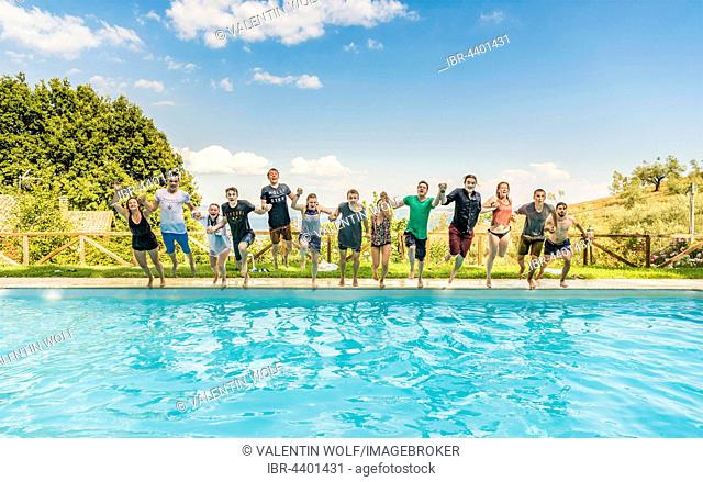 Group of teenagers, Teens jumping in pool, Lazio, Italy