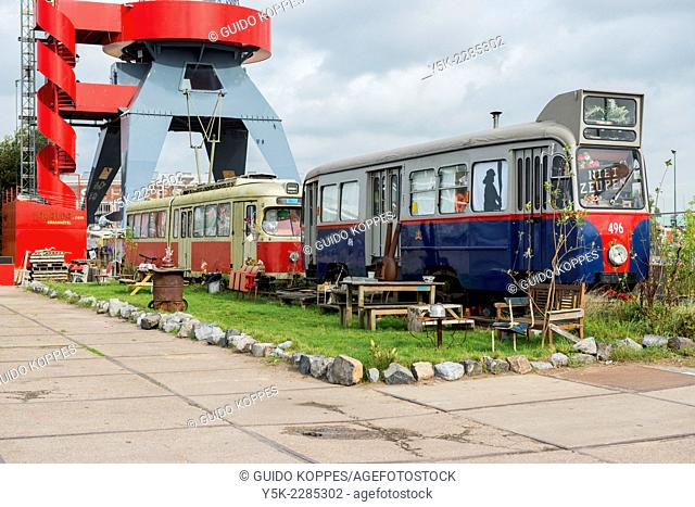 NSDM Warf, Amsterdam, Netherlands. Old tram trollies recieved a second life and purpose as urban cafe's on the former NSDM Warf