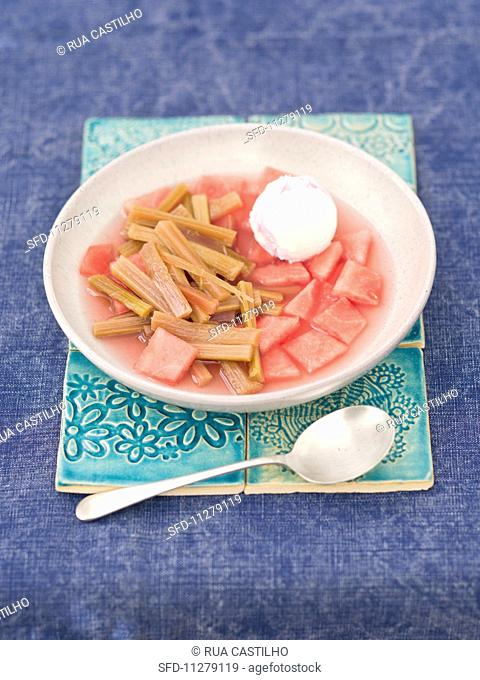 Cold watermelon and rhubarb soup with strawberry and vanilla ice cream