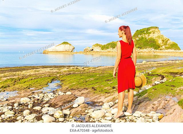 Woman looking to sea landscape