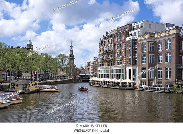 Netherlands, Amsterdam, view over Amstel river to Munttoren