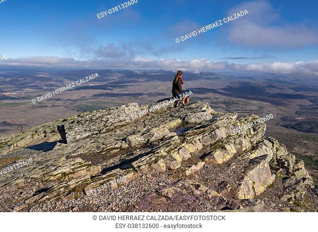 Young woman tourist looking a mountain landscape in Pena the Francia, famous destination in Salamanca, Spain