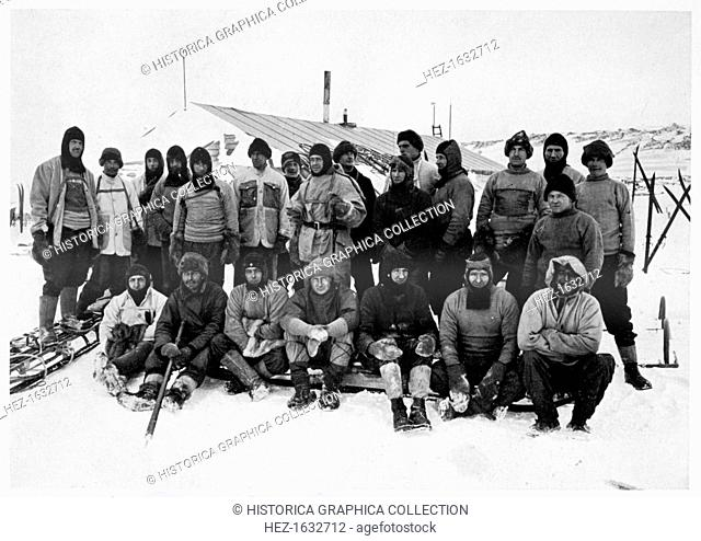 'The Main Party at Cape Evans after the Winter', Scott's South Pole expedition, Antarctica, 1911. Group portrait of the members of the expedition taken before...