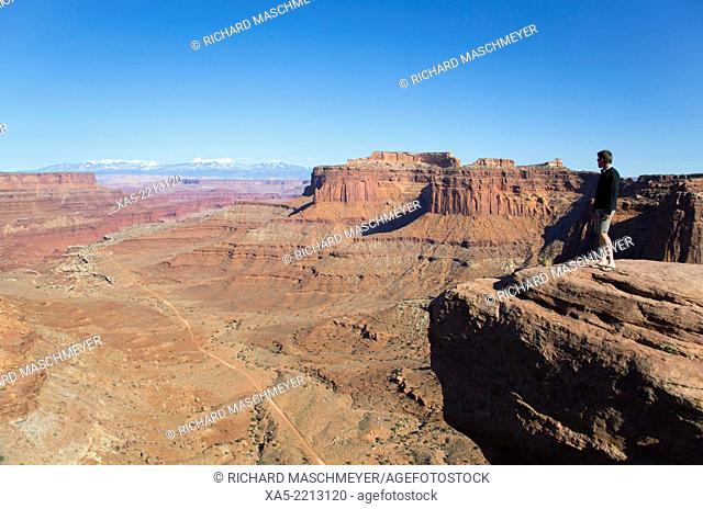 USA, Utah, Canyonlands National Park, from Schafer Trail Road, tourist enjoying the view