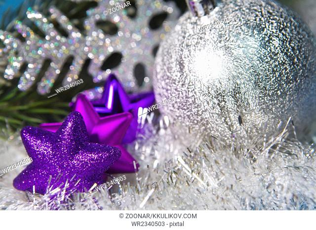 hree decorative violet toys of a snowflake and sil