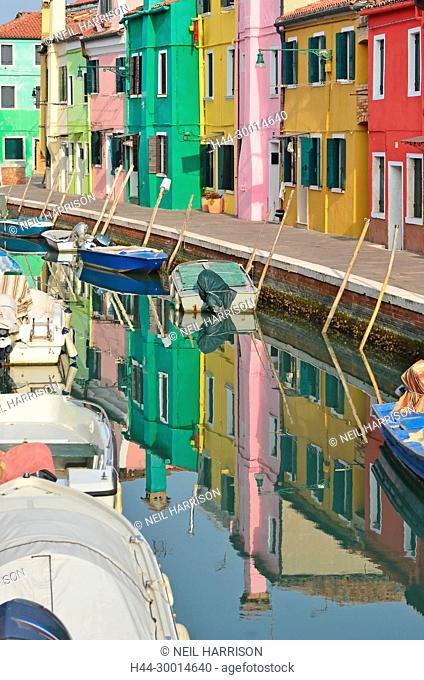 Canal lined with colorful houses in the middle of the pretty little island of Burano in the Venice lagoon