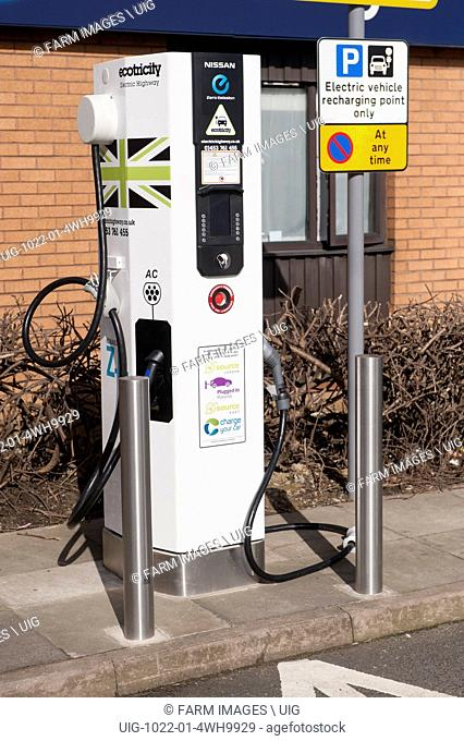 Recharging point for electric cars at a motorway service area. UK. (Photo by: Wayne Hutchinson/Farm Images/UIG)