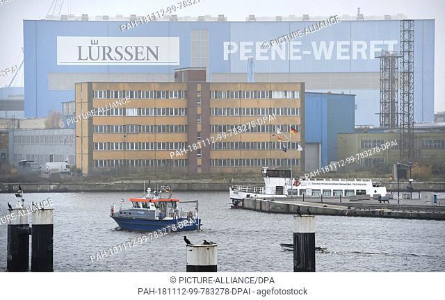 10 November 2018, Mecklenburg-Western Pomerania, Wolgast: The logo of the Lürssen shipyard hangs on a shipbuilding hall of the Peene shipyard