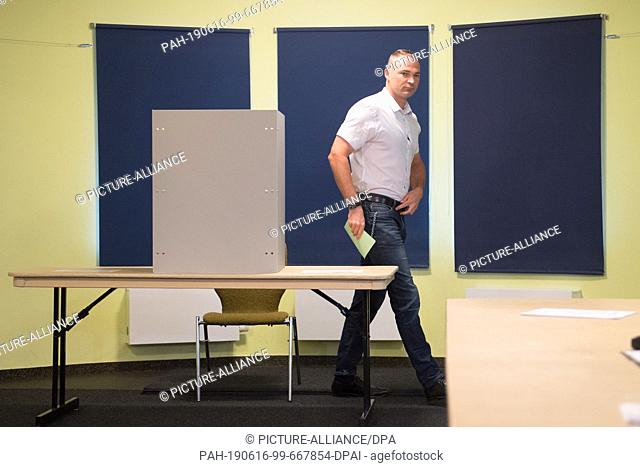 16 June 2019, Saxony, Görlitz: Sebastian Wippel, AfD Member of State Parliament and Lord Mayor candidate for Görlitz, holds his ballot after the vote in a...