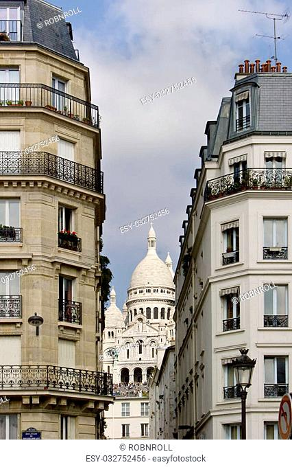 The Sacre Coeur viewed from the Boulevard de Rouchechouart in Paris, France