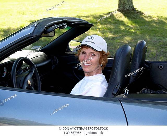 Woman sitting in a Porsche in Belchertown, MA, USA