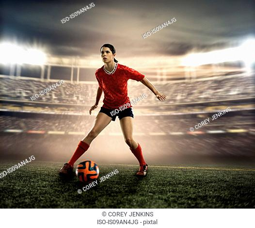 Footballer in mid dribble