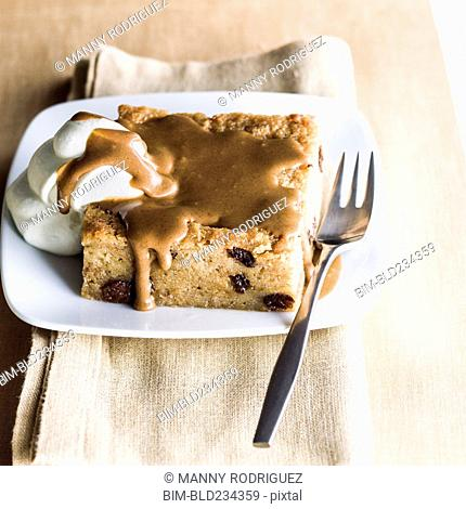 Bread pudding dessert on plate with fork