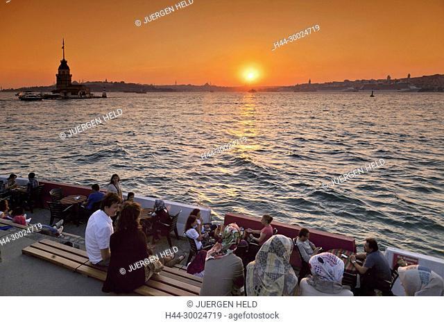 Lounge at Bosporus waterfront, Kis Kulesi tower, sunset, Istanbul, Turkey , Europe