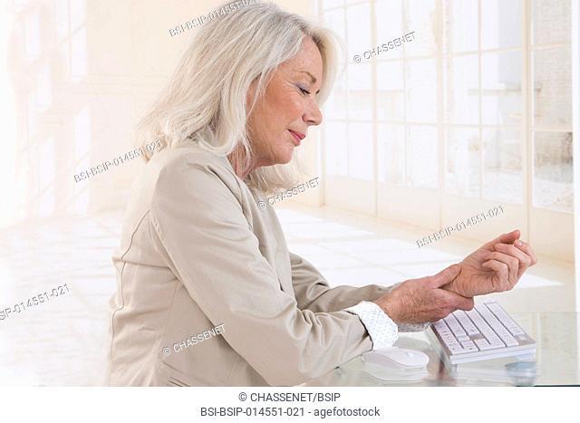 Senior woman suffering from wrist pain
