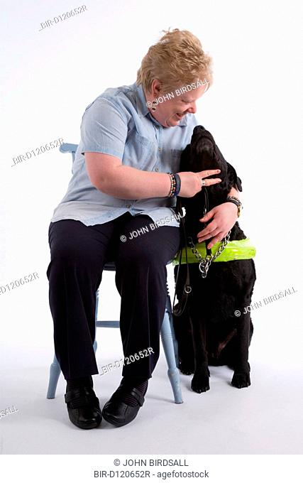 Blind woman with her guide dog