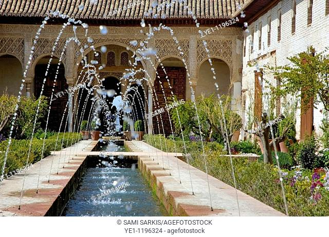 Water fountains in the courtyard at Alhambra, a 14th-century palace in Granada, Andalusia, Spain