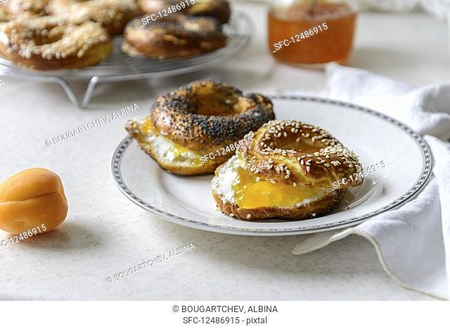 Closeup view of freshly baked bagels with apricot jam filling