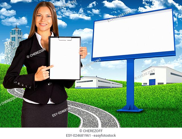 Businesswoman holding paper holder. Blank billboard, road, skyscrapers and industrial area as backdrop