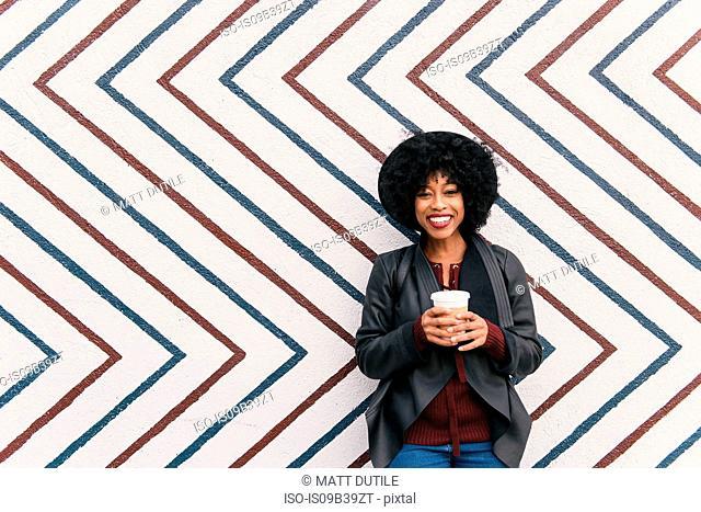Portrait of woman in front of zig zag pattern wall