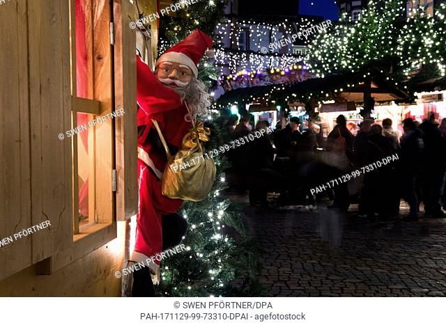 A Santa Claus figure hangs on the window of a stand at the Christmas market in Goslar, Germany, 29 November 2017. The Christmas market in Goslar is open from 29...