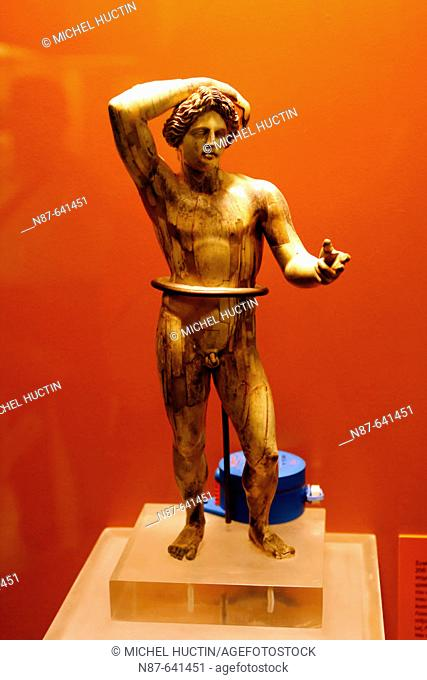 Ivory statuette of Apollo lykeios (3rd century BC) in the Ancient Agora Museum (Stoa of Attalos), Athens. Greece