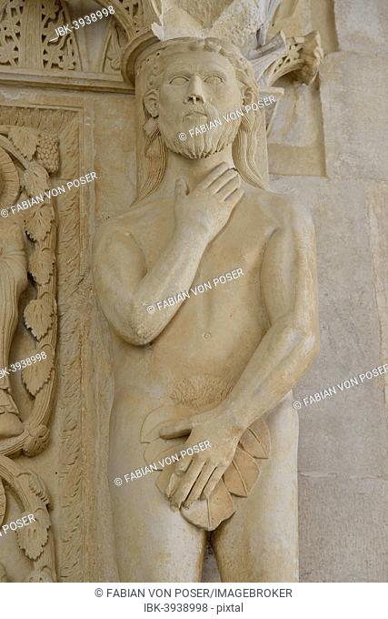 Adam with a fig leaf on the western gate of Trogir Cathedral or Cathedral of St. Lawrence, 13th century, by the artist Radovan, historic centre