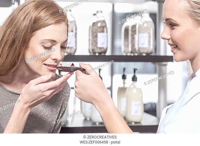 Client and shop assistant in wellness shop