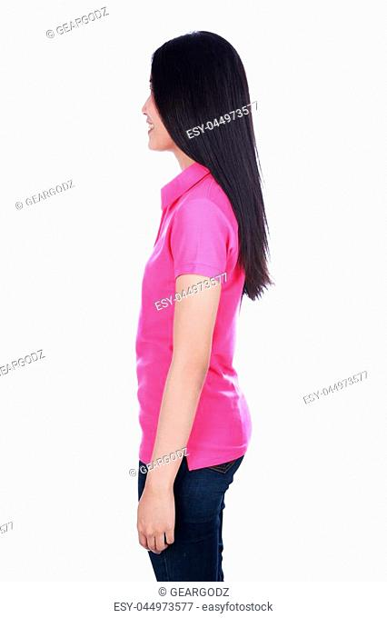 woman in pink polo shirt isolated on a white background (side view)