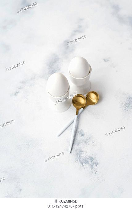 Two eggs in eggcups and spoons