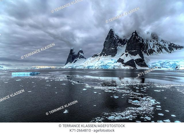 Scenic landscape of mountains and glaciers in the Neumayer Channel of the Antarctic Peninsula