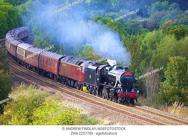 LMS Stanier Class 8F 48151, steam train near Low Baron Wood Farm Armathwaite Eden Valley, Cumbria, England, UK