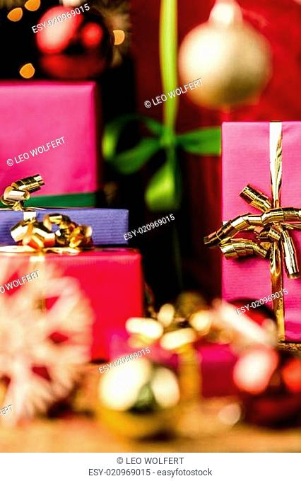 Magenta and Blue Gifts amidst Golden Glitter