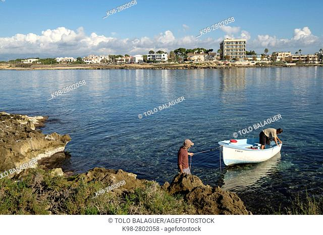 Boat arriving at Punic archaeological site in Na Galera islet, Can Pastilla, Palma, Mallorca, balearic islands, spain, europe