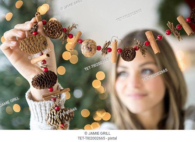 Woman preparing christmas decoration