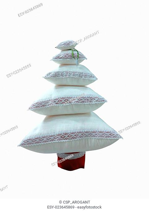 Abstract creative Christmas tree made from cushions isolated over white background
