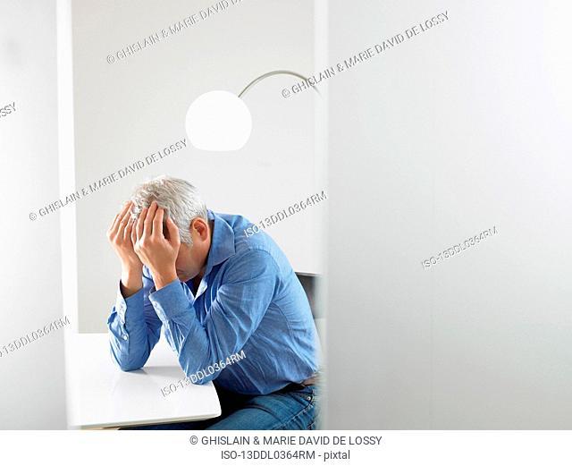 Desperate man at his desk
