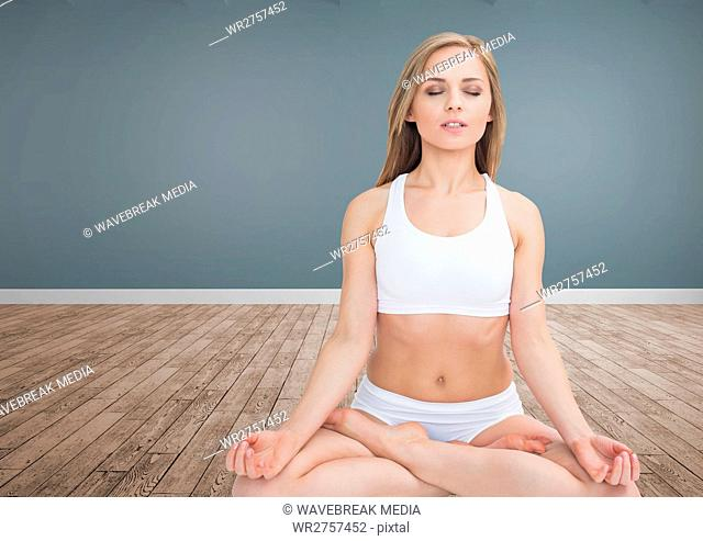 Woman Meditating in room