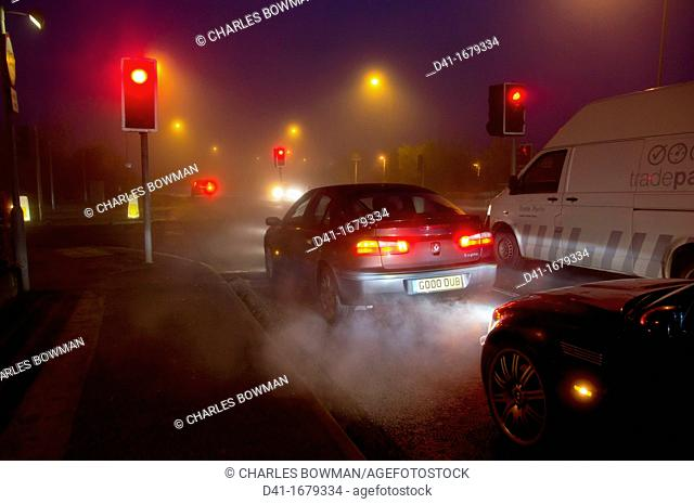 Street exhaust fumes in fog