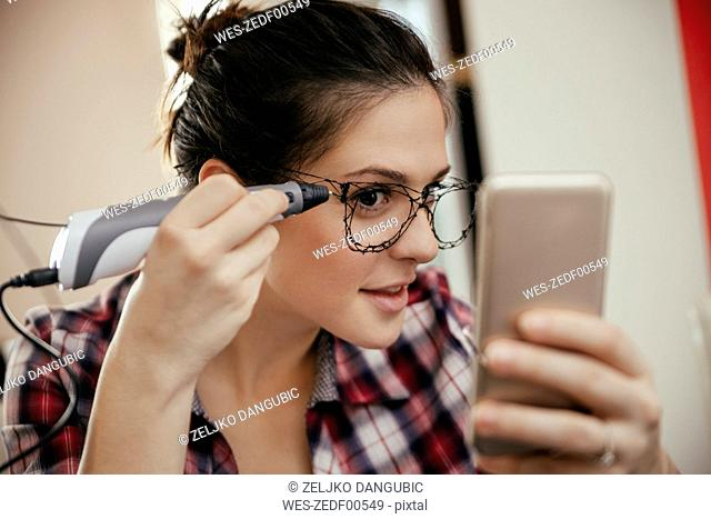 Young woman with spectacles, drawn with a 3D pen