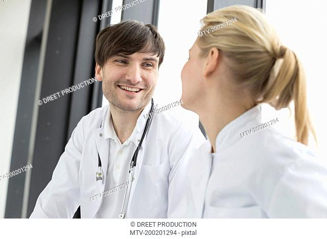 Doctors having conversation, smiling