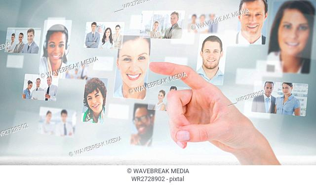 Finger touching profile picture of business people