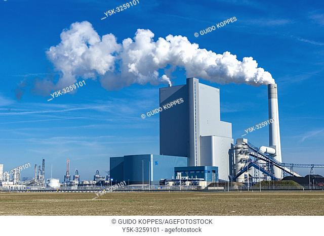 Rotterdam, Netherlands. Newly build and modern Fossil Fuel (Coal) electricity producing power plant on Port of Rotterdam's 2nd Maasvlakte still emits large...