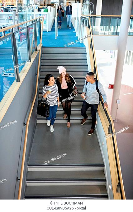 University students going down stairs