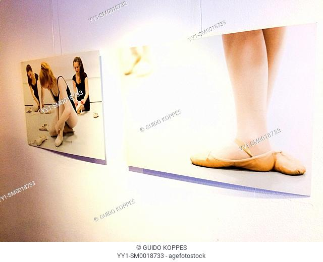 Rotterdam, Netherlands. Two photo prints of female ballet dancers on the wall at Galery Via Kunst