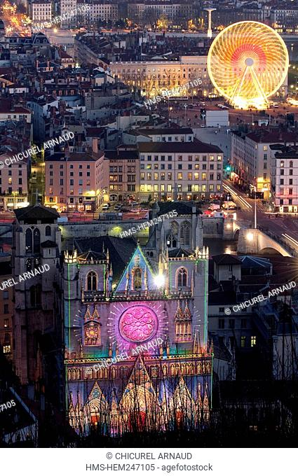 France, Rhone, Lyon, historical site listed as World Heritage by UNESCO, Fete des Lumieres Light Festival, Saint Jean Cathedral and the big wheel of Place...