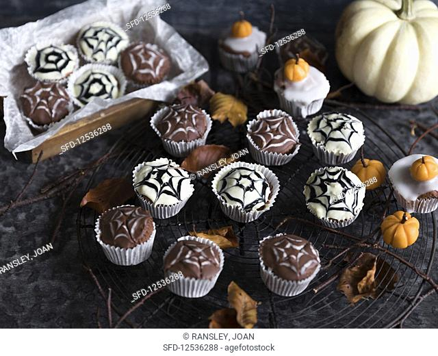 Spider cupcakes decorated with a cobweb for Halloween